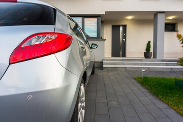 House driveway with a car parked on the front