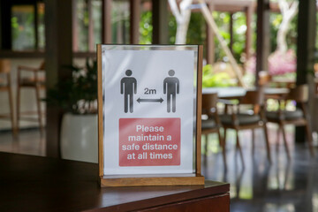 Social distancing sign at the entrance of restaurant as a reminder that everyone needs to comply...