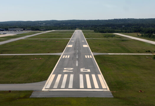 Runway approach at a small rural airport in the eastern United States.