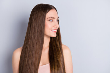 Closeup photo of pretty charming lady white teeth smiling presenting ideal neat long hairstyle look empty space wear beige singlet isolated grey color background Wall mural