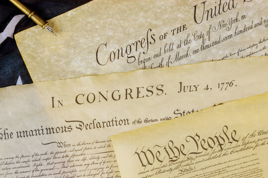 U.S. document of American constitution We the people with USA Flag.