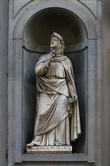 Statue of Francesco Petrarca, famous italian poet, outdoor the uffizi museums, Florence, Italy
