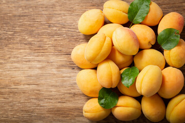fresh ripe apricots on a wooden table, top view