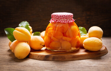 jar of canned apricots and fresh fruits