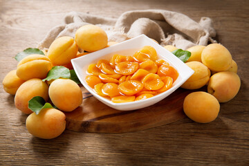 bowl of canned apricots and fresh fruits