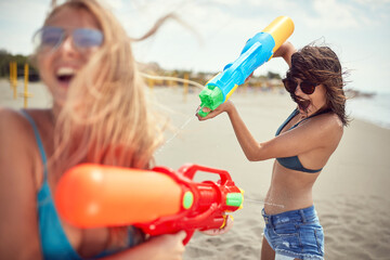 Crazy  girl attacked her frinds with water gun at beach at vacation.
