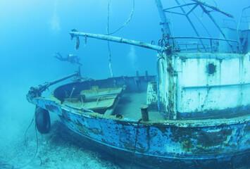 Acrylic Prints Shipwreck Scuba Divers Exploring underwater ship wreck