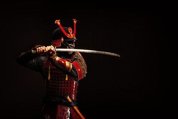 Portrait of a samurai in armor in attack position