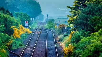 The railway line heading north out of Brora in Sutherland in the Highlands