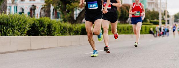 Wall Mural - three leading athletes runners run city marathon race