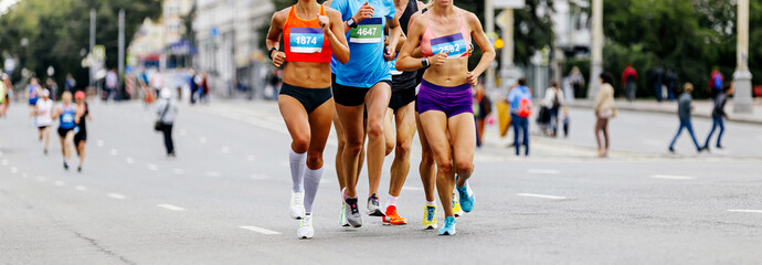 Wall Mural - leading group women runners running city marathon race
