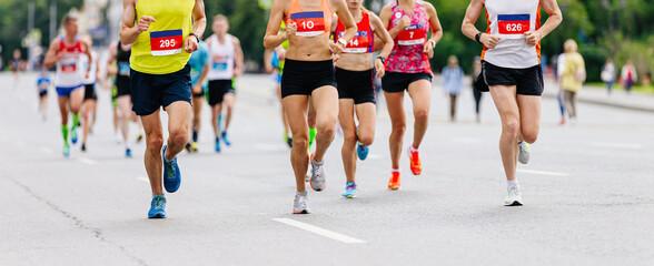 Wall Mural - group runners athletes men and women run on asphalt marathon race