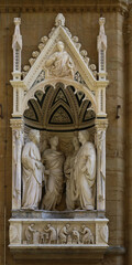 Sculpture of Four Crowned Martyrs or Four Saints, and masters of wood and stone workers, Orsanmichele church, Florence, Tuscany, Italy, touristic place