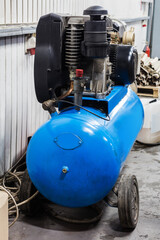 compressor with motor in modern workshop