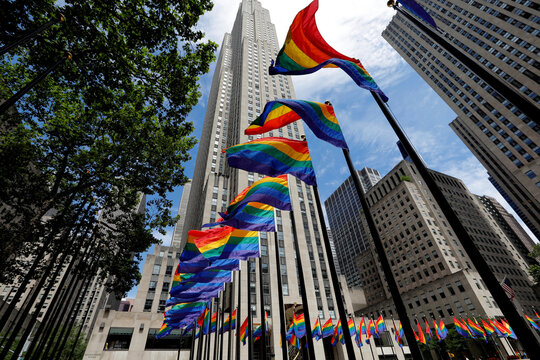 Rainbow flags fly at Rockefeller Center in midtown Manhattan in support of the LGBT community in New York