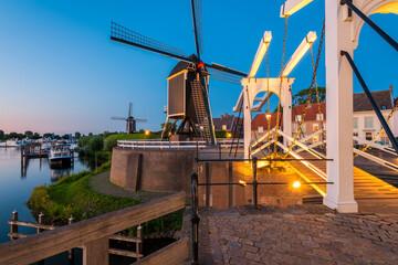 Draw Bridge and Windmills in Heusden Netherlands at Dusk