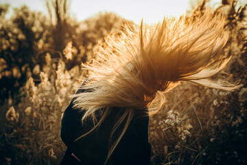 girl's hair develops in the wind autumn background picture