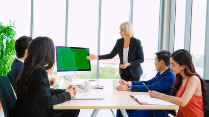 Business people in the conference room with green screen chroma key TV or computer on the office...