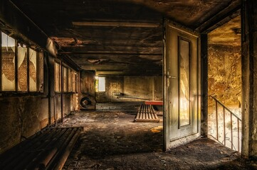 Inside view of an old abandoned building with broken windows