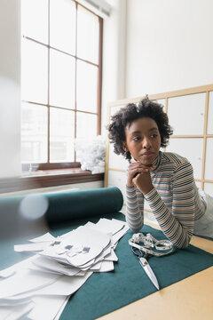 Woman working in fabric design studio