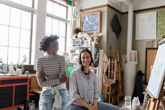 Portrait of two women in art studio
