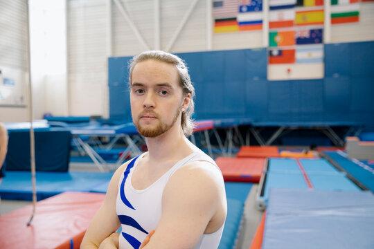 Male gymnast with beard in gymnasium