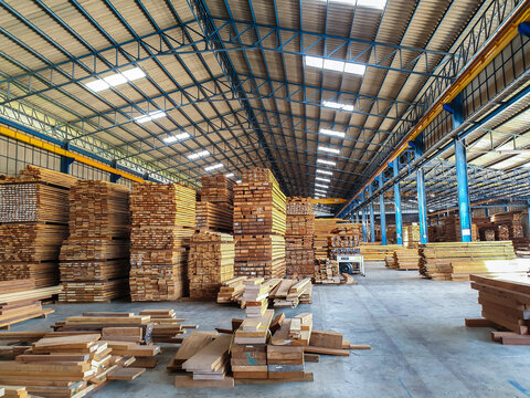 Lumber - Wood factory stock or timber in warehouse. ,Piles of wooden boards  waiting for shipping. Lumber, Business, production, manufacture and woodworking industry concept