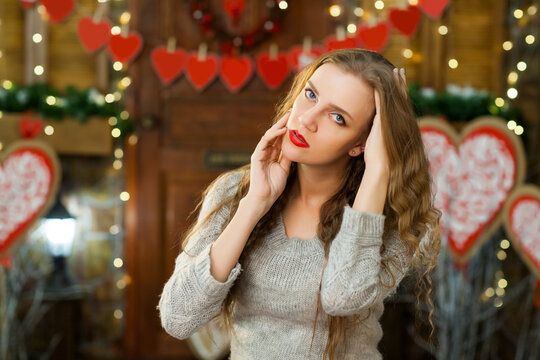 attractive woman in love in grey warm sweater celebrate valentine's day and waiting for man