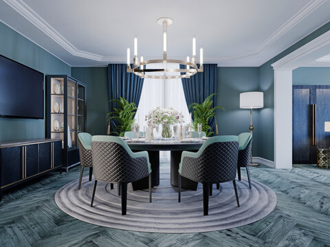 Modern luxurious dining room in blue, white and black color with a large round served table and chairs.