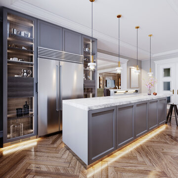 A modern kitchen island made of wooden panels with a chamfer of gray color, with a white marble countertop and two bar stools. Built-in sideboard metal refrigerator, dishes on the shelves.
