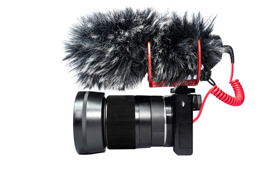 Camera for video recording With a professional mic or shotgun mic For shooting vlog or production work . Isolate , White background