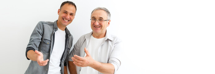 Senior Father With Adult Son isolated on white background