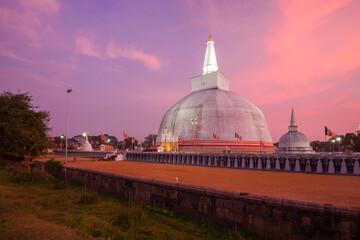 View of the ancient Ruwanweli Maha Seya Dagaba in lilac twilight. Anuradhapura, Sri Lanka