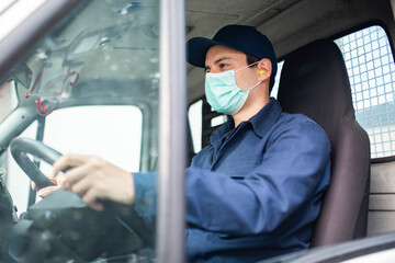 Truck driver giving driving a van during coronavirus pandemic