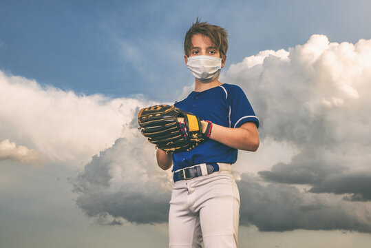 Baseball Boy With Face Mask Outside