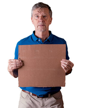 Senior caucasian man holding a blank cardboard sign for copy space message. He is isolated against a white background