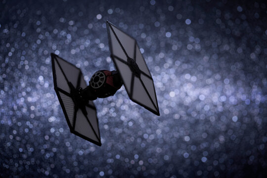 NEW YORK USA - JUNE 1 2020: First Order Tie Fighter from Star Wars The Force Awakens, flying through a star field - Hasbro miniature ship