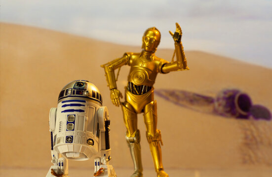 NEW YORK USA - MAY 13 2020: Recreation of a scene from Star Wars A New Hope depicting droids C-3PO and R2D2 on the desert planet of Tatooine with escape pod - Hasbro action Figure