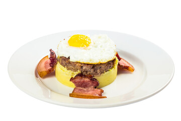 mom made breakfast. fried egg and meat patty on top of smashed potato, decorated with bacon. food isolated on the white background. side view