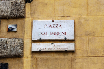 Street sign of Piazza Salimbeni is square in old town Siena. Italy.
