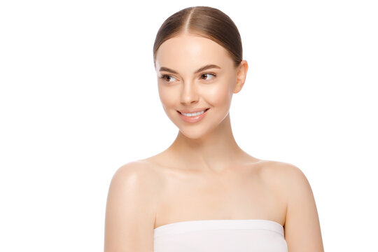 Beauty woman face with brown eyes looking aside, isolated on white background. Skin care treatment or cosmetic ads. Beautiful female model with perfect fresh and clean skin