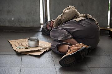 Homeless old beggar sleep on walkway