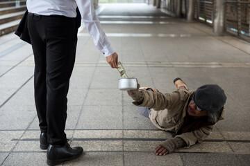 Kind man give money to old beggar