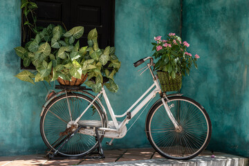 Papiers peints Velo White vintage bike with basket full of flowers next to an old building in Danang, Vietnam, close up