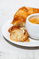 espresso and fresh croissants, vertical closeup