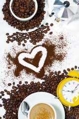 espresso cup, alarm clock, heart and coffee beans conceptual photography