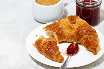 fresh croissant, coffee and strawberry jam, white background