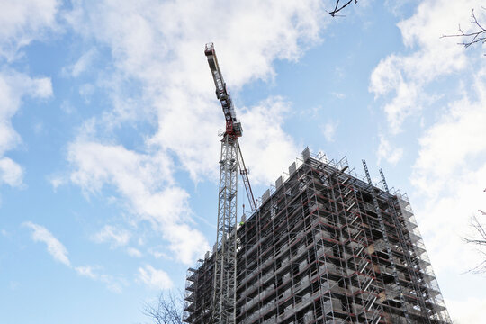 Construction site of a skyscraper building with a big crane, copy space