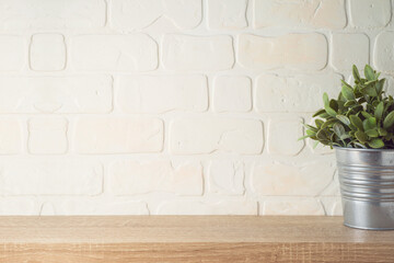 Tuinposter Planten Empty wooden shelf with plant over brick wall interior. Kitchen mock up for design