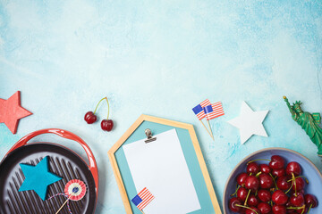 Celebrate at home 4th of July concept with photo frame and patriotic home decor. Top view from above